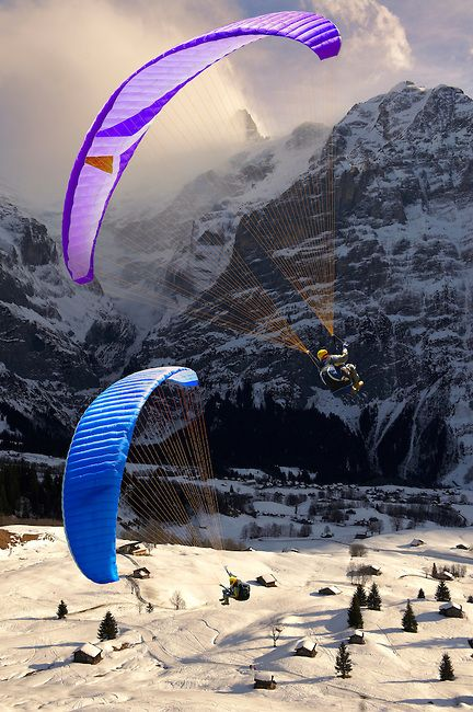 Paragliders in the Swiss Alps above the Grindelwald valley