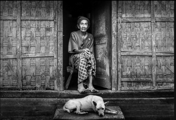 Old Lady with her old dog in her Old house